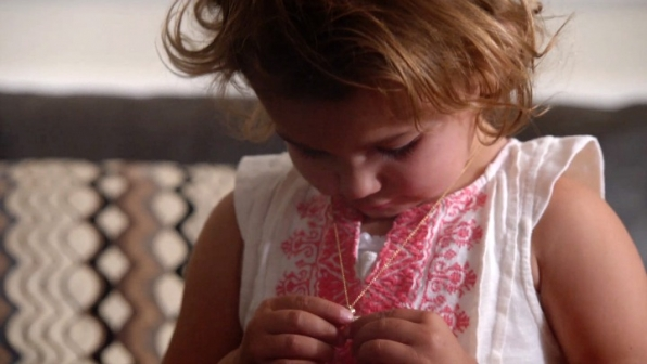 DiNozzo gives Tali her mother's necklace.