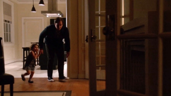 DiNozzo chases Tali around the apartment.