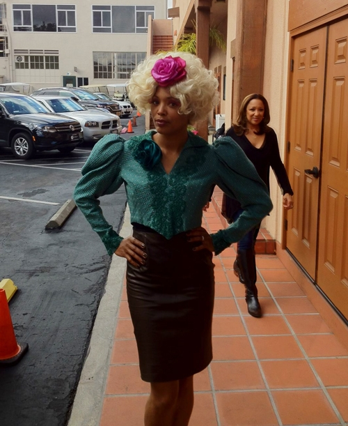 Aisha Tyler is Effie Trinket