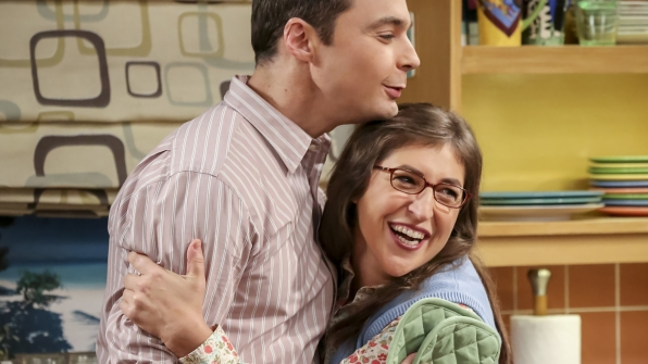 Sheldon and Amy share a hug.