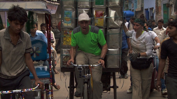 Justin bikes through the market with a heavy load of 120 cans.