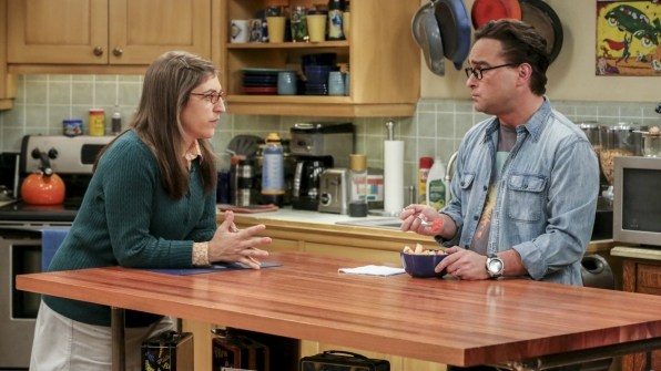 Leonard talks with Amy in the kitchen.