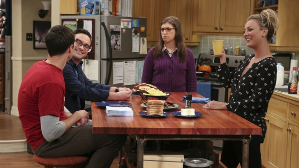 Penny and Amy greet Sheldon and Leonard with breakfast.