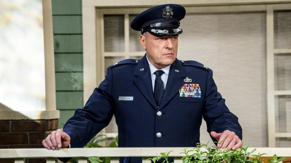 Colonel Williams (Dean Norris) stands pensively on Howard's porch.