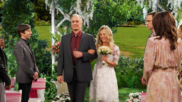 Penny's father, Wyatt, walks her down the aisle.