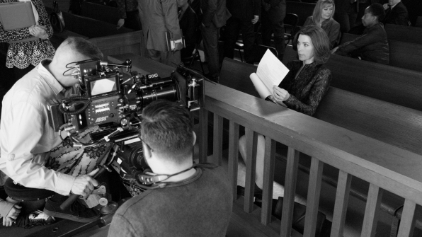 Julianna Margulies reads her script before filming starts.