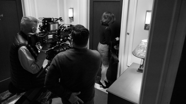 Robert King directs as Julianna Margulies enters Alicia's apartment.