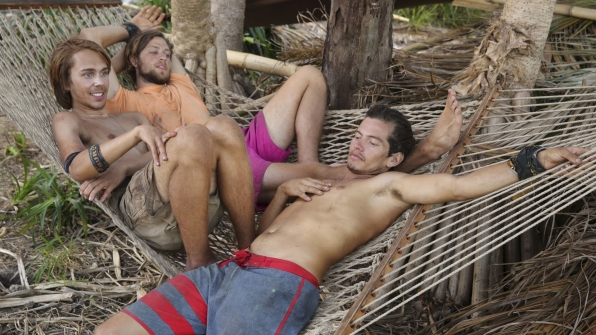 Will, Taylor, and Jay swing in the hammock.