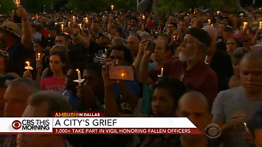More than a thousand honor fallen Dallas officers at vigil